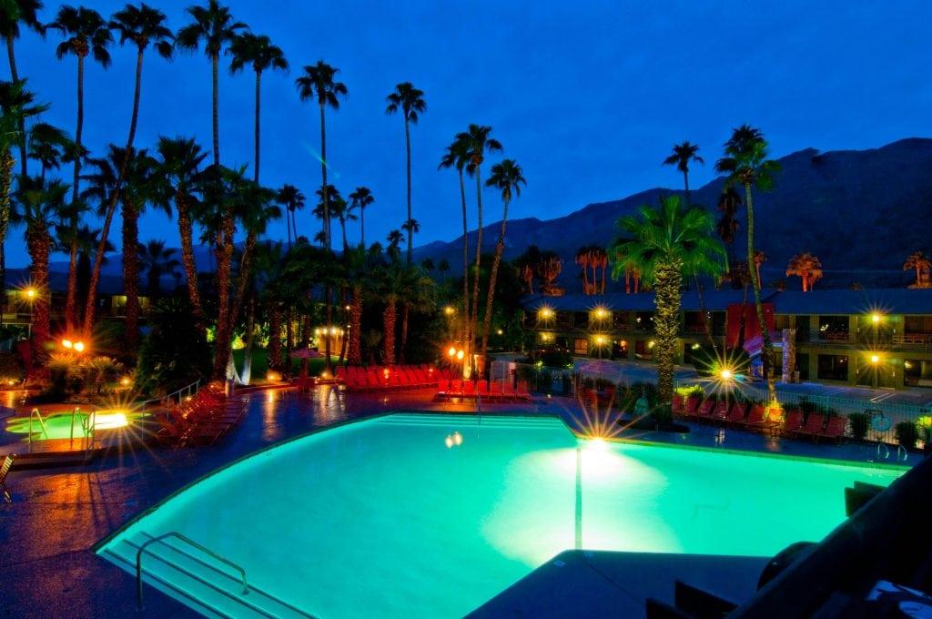 Pool at Night - Caliente Tropics Resort Hotel
